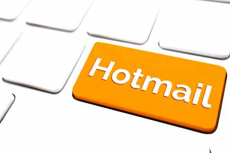 What are the steps to add a contact in Hotmail
